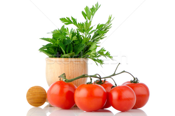 Tomatoes and green herb leafs  Stock photo © homydesign