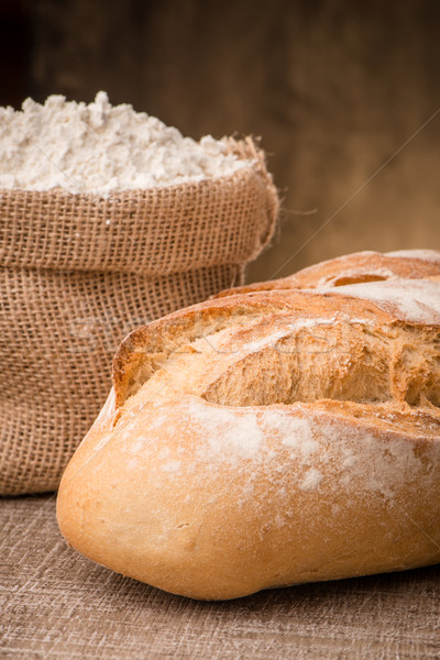 Rustic bread and flour Stock photo © homydesign