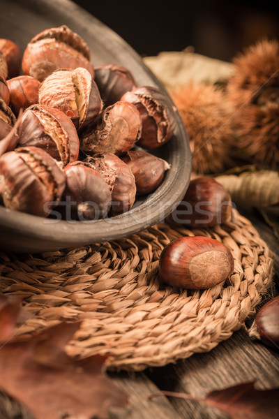 Roasted chestnuts and leaves Stock photo © homydesign