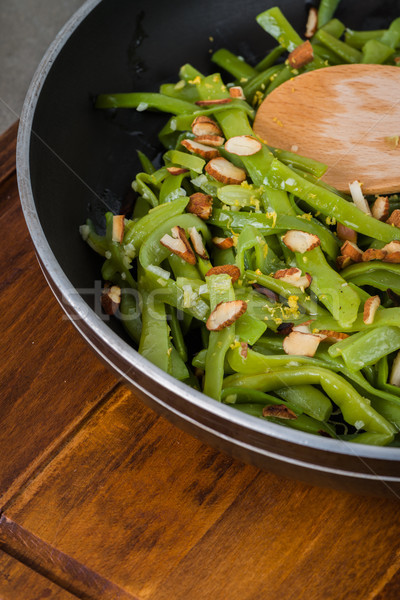 Zöldbab pörkölt mandulák serpenyő konyha étel Stock fotó © homydesign