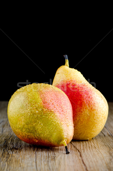 Pears in a old wooden table Stock photo © homydesign