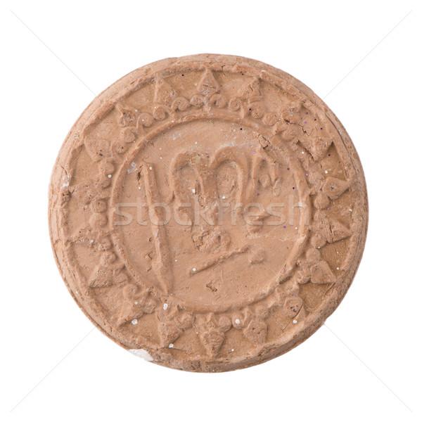 Antique ancient ceramic coin Stock photo © homydesign