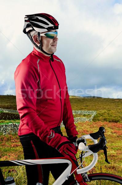 Cyclist and his bike Stock photo © homydesign