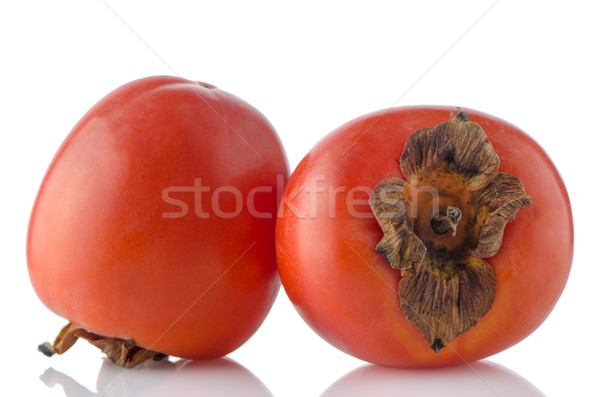 Red ripe persimmons Stock photo © homydesign