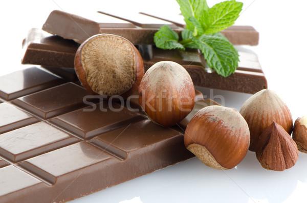 Csokoládé szelet mogyoró friss menta fehér levél Stock fotó © homydesign