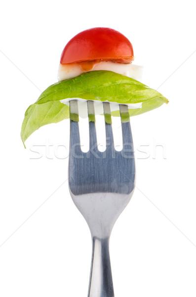 Insalata caprese forcella ingredienti isolato bianco verde Foto d'archivio © homydesign
