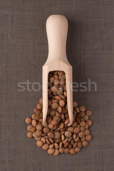 Wooden scoop with lentils Stock photo © homydesign