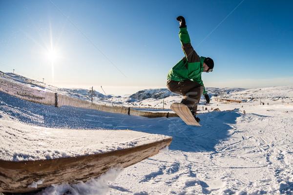 Snowbordos ugrik kék ég fa sín sport Stock fotó © homydesign