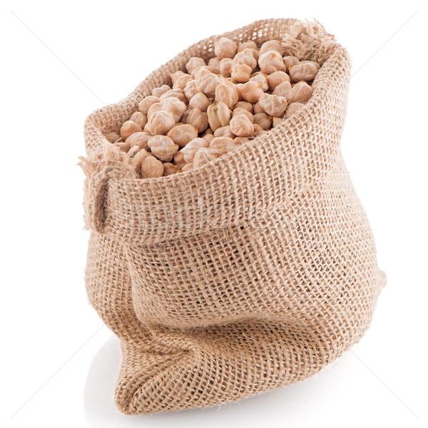 Uncooked chickpeas on burlap bag Stock photo © homydesign