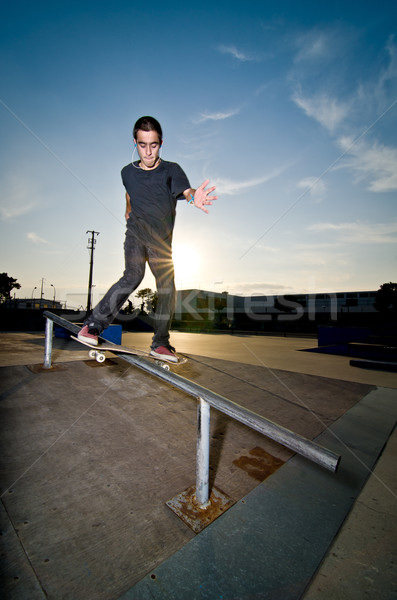 Skateboarder on a slide Stock photo © homydesign