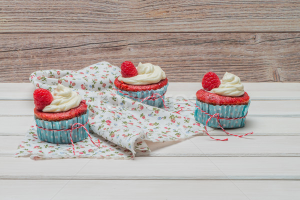 Red cupcakes with cream cheese frosting Stock photo © homydesign