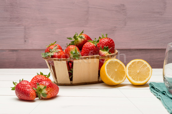 Strawberries in a small basket and lemon Stock photo © homydesign