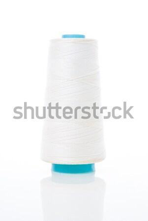 Bobbin of white thread Stock photo © homydesign