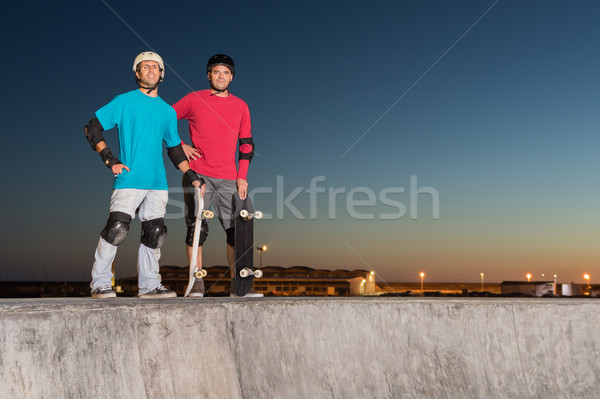 Two skateboarders standing near a concrete pool  Stock photo © homydesign