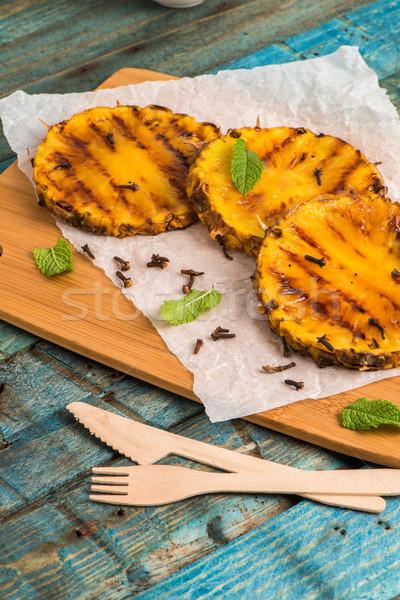 Grillezett ananász szeletek fa asztal gyümölcs saláta Stock fotó © homydesign