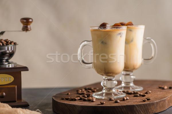 Iced coffee in glass jars Stock photo © homydesign
