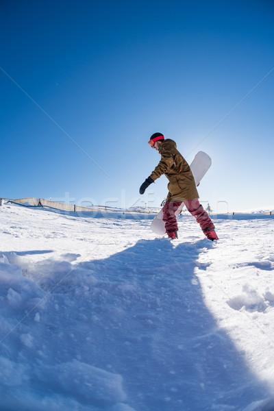 Snowbordos sétál kék ég mély friss hó Stock fotó © homydesign
