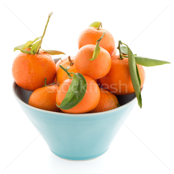 Tangerines on ceramic blue bowl  Stock photo © homydesign