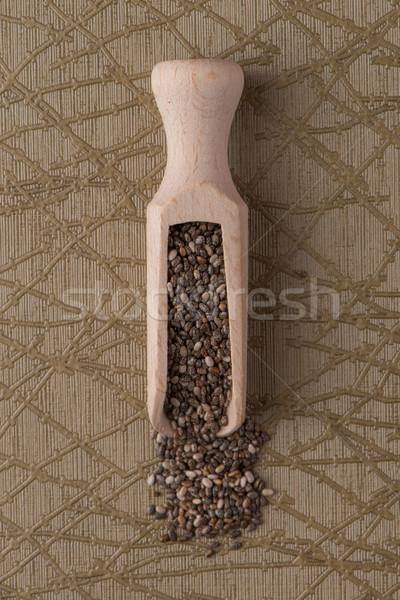 Wooden scoop with chia seeds Stock photo © homydesign