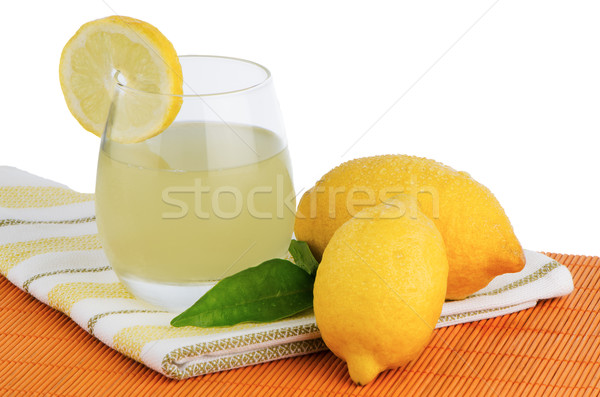 Cup of lemon juice and fresh lemons Stock photo © homydesign
