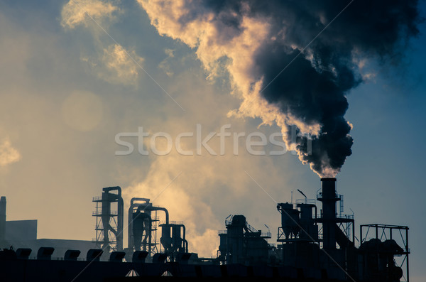 Smoking chimney  at sunset  Stock photo © homydesign