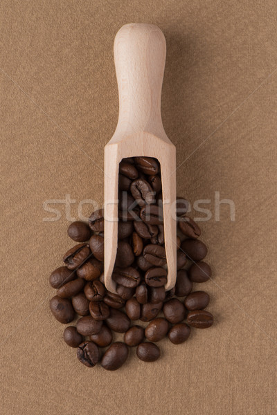 Wooden scoop with coffee beans Stock photo © homydesign