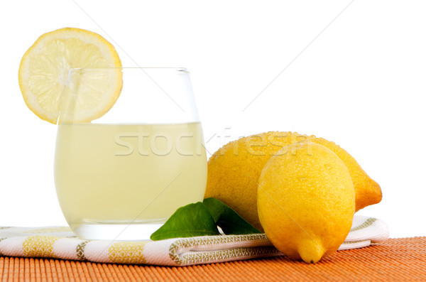 Stock photo: Cup of lemon juice and fresh lemons