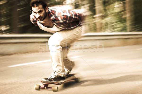 Downhill skateboarder in action Stock photo © homydesign