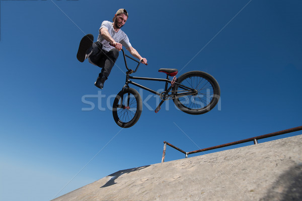 BMX Bike Stunt tail whip Stock photo © homydesign