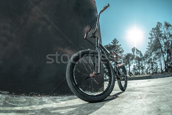 Bmx bike standing against black  wall Stock photo © homydesign