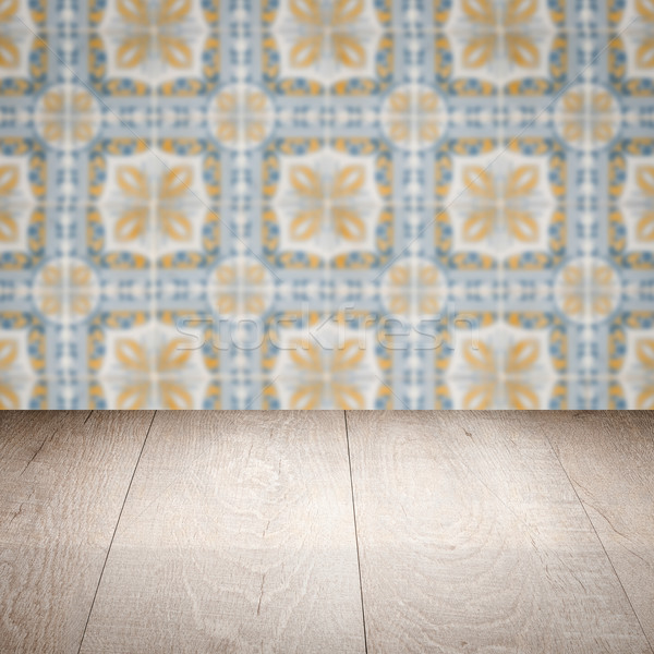 Stock photo: Wood table top and blur vintage ceramic tile pattern wall