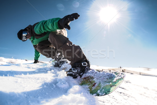 Snowboard freerider in the mountains Stock photo © homydesign