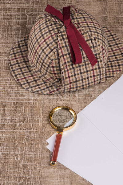 Stock photo: Wrapped paper sheets and magnifying glass