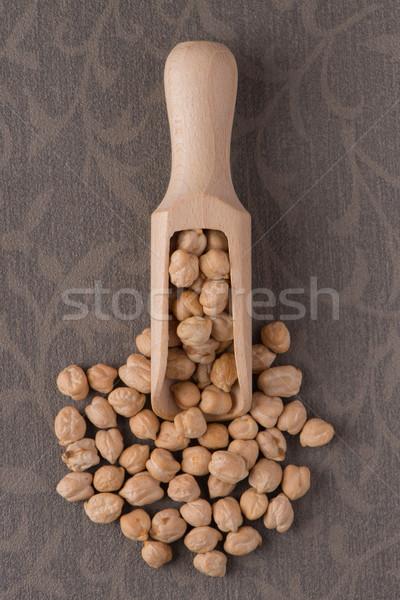 Wooden scoop with chickpeas Stock photo © homydesign