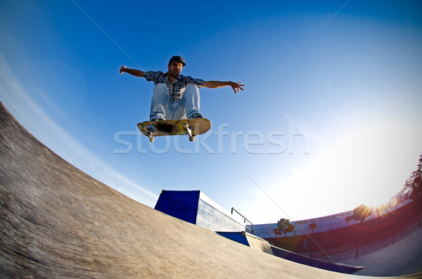 Skateboarder flying Stock photo © homydesign