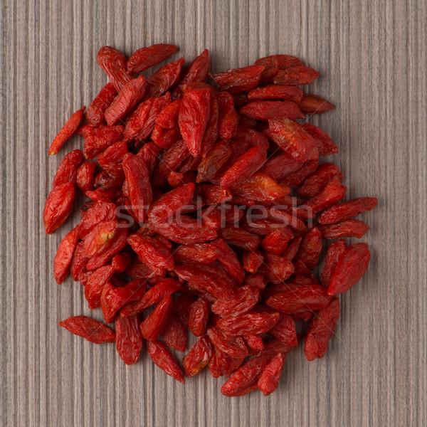 Circle of dry red goji berries Stock photo © homydesign
