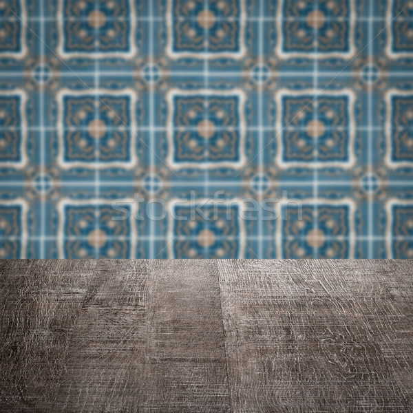 Wood table top and blur vintage ceramic tile pattern wall Stock photo © homydesign