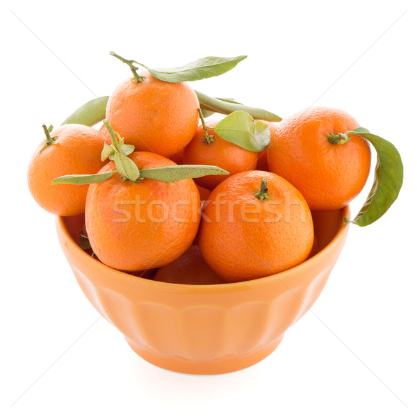Tangerines on ceramic orange bowl  Stock photo © homydesign