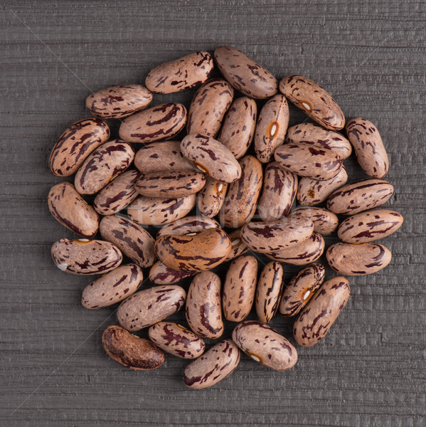 Circle of pinto beans Stock photo © homydesign