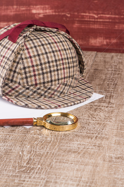 Stock photo: Paper sheets and magnifying glass