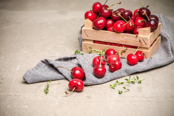 Red ripe cherries in small wooden box Stock photo © homydesign
