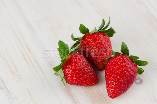 Three fresh strawberries Stock photo © homydesign
