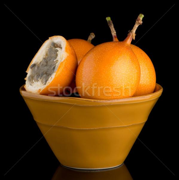 Szenvedély gyümölcs kerámia citromsárga tál fekete Stock fotó © homydesign