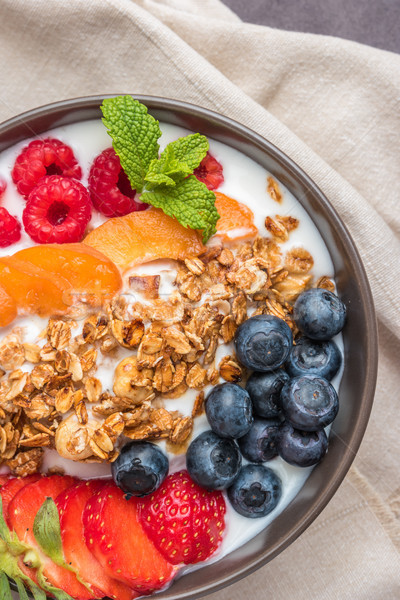 Yogurt with baked granola and berries Stock photo © homydesign