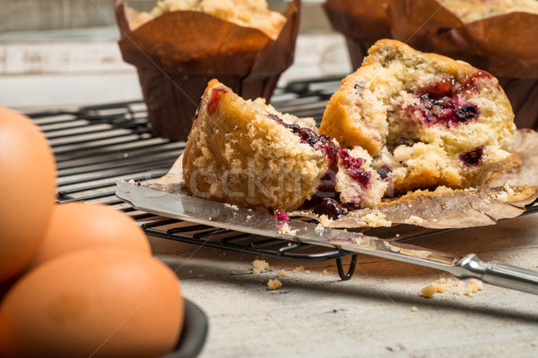 Muffins with red fruits jam fill. Stock photo © homydesign