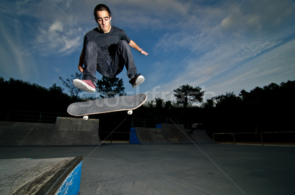 Skateboarder on a flip trick Stock photo © homydesign