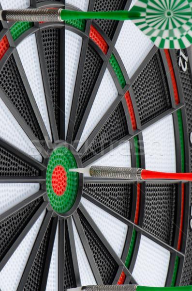 Dart board with darts Stock photo © homydesign