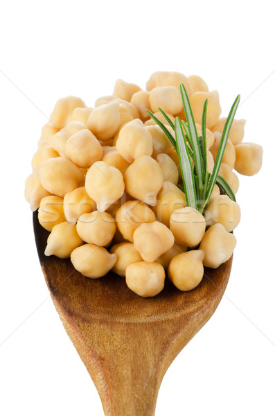 Chickpeas over wooden spoon Stock photo © homydesign