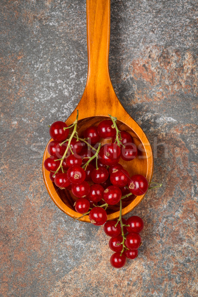 Currants in a wooden spoon Stock photo © homydesign