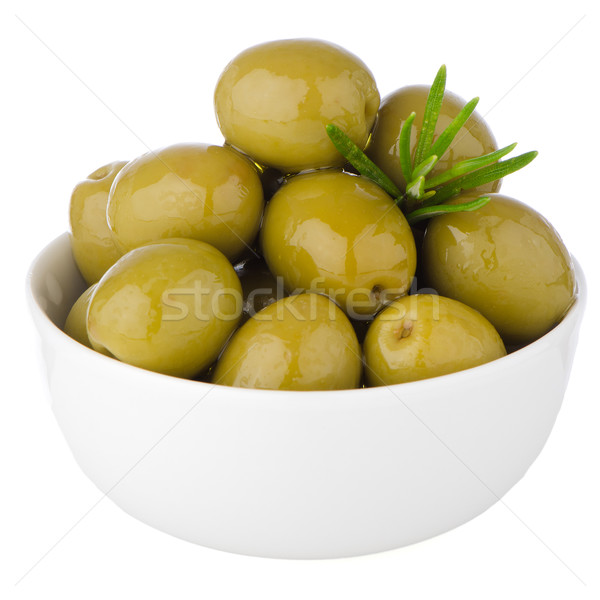 Green olives in a white ceramic bowl Stock photo © homydesign